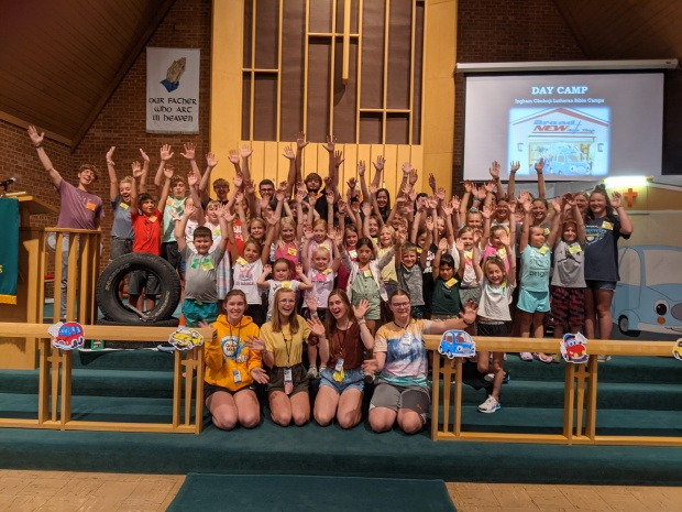 VBS 2021 group with hands up